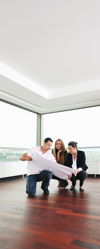 People Looking at a Home Floorplan